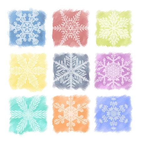 水彩パステルのマルチカラーの雪片のセット。クリスマスと休日の装飾、飾り、背景。