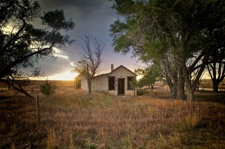 abandoned house at sunset with overcast sky Stock Photo - 6602991