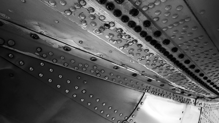 AIRCRAFT RIVETS CLOSE UP.  UNDER WING OF VINTAGE AIRCRAFT.