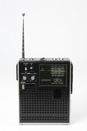 Vintage transistor radio on white Stock fotó