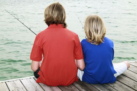 Two brothers fishing in an urban lake photo