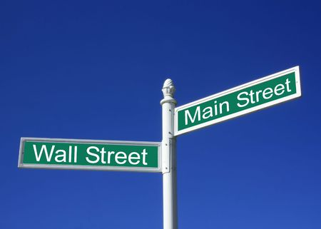 Wall street vs Mainstreet conceptual sign against a clear blue sky