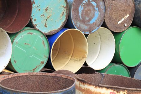 Background of colorful old rusty abandoned metal barrels Stock fotó