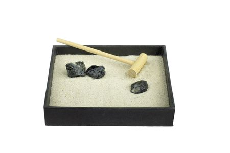 Miniature Zen garden with rake isolated on white Stock Photo - 5795679