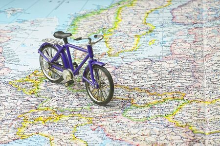 Bicycle on map exploring the continents saving gas