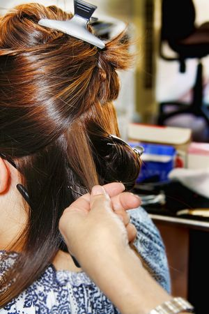 Female at the hairstylist getting a hairdo Stock Photo