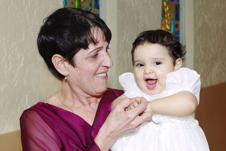 Close-up of a Hispanic Grandmother and Granddaughter Stock Photo