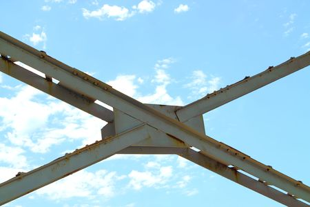 Steel cross beams against a blue sky Stock Photo - 7533936