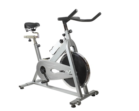 """Type of Exercise bicycle  called """"spinner"""" isolated on white"""