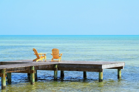 wooden dock: Two Chairs waiting to be occupied by you in your next vacation