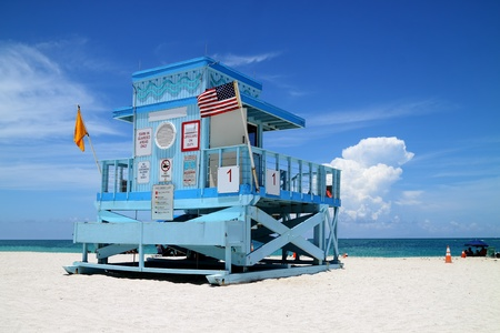 Beautiful colorful scene of a fancy lifeguard hut on North Miami Beach on a sunny day photo