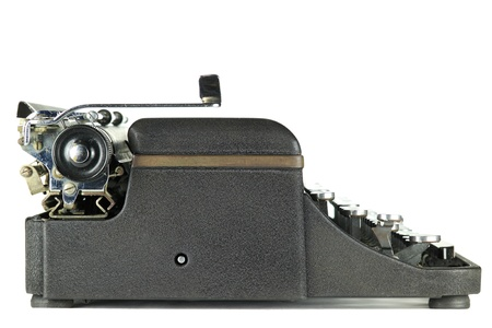 type writer: Side view of a Black worn vintage typewriter on white background