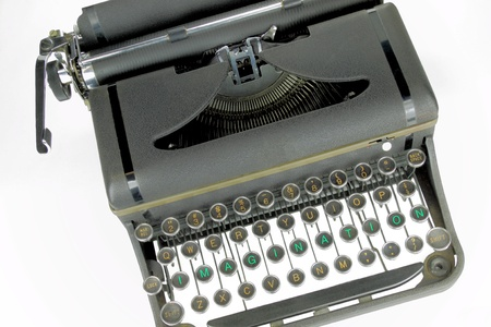 Inspiration for writers and artist to portray ideas and motivation written on a closeup of an old typewriter keyboard photo