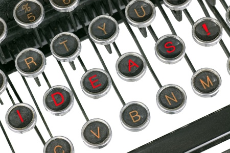 Ideas for writers and artist to portray ideas and motivation written on a closeup of an old typewriter keyboard photo