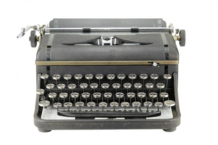 type writer: Front view of a Black worn vintage typewriter on white background Stock Photo