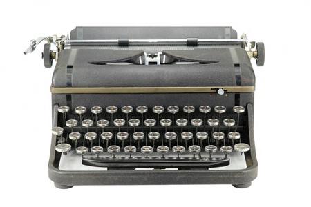 Vooraanzicht van een versleten zwarte vintage schrijfmachine op een witte achtergrond Stockfoto
