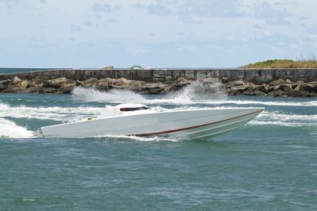 Fast offshore cigarette race boat coming back from a race