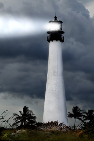 View of the Cape Florida lighthouse in the Bill Baggs State park during a stormy night on Key Biscayne in Miami Florida  photo