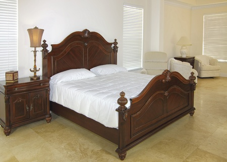 Overview of a beautiful classic bedroom suite in a private residence with a travertine floor photo