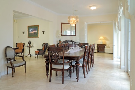 classic furniture: View of a beautiful classic rich dining room with travertine floor