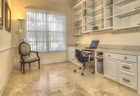 Contemporary home office with book cabinets, shelves, and workspace  photo