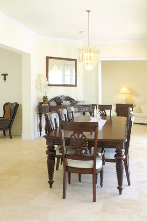 classic living room: View of a beautiful classic rich dining room with travertine floor