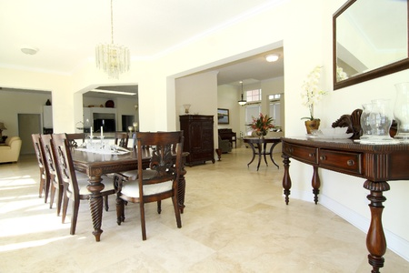 View of a beautiful classic rich dining room with travertine floor