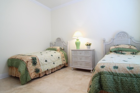 Overview of a beautiful contemporary  bedroom in a private residence with a travertine floor photo