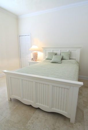 Overview of a beautiful contemporary  bedroom in a private residence with a travertine floor