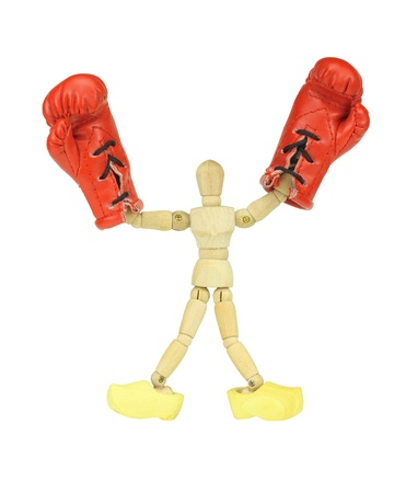 wooden mannequin: Wooden mannequin with boxing gloves and wooden shoes Stock Photo