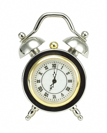 seven o'clock: Old-fashioned alarm clock set for seven o�clock in the morning to start a new day