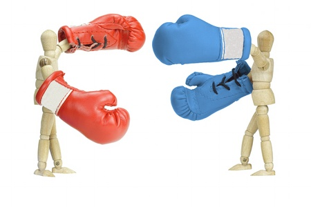 Fighting wooden Mannequins symbolizing the American political parties Stock Photo