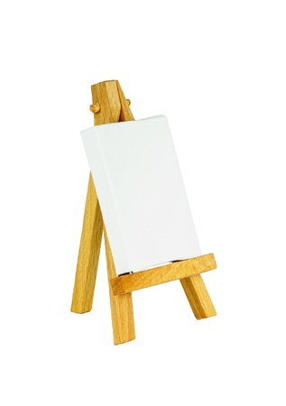 Easel with a blank canvas to be used for text and other purposes by the designer Stock Photo - 11811435
