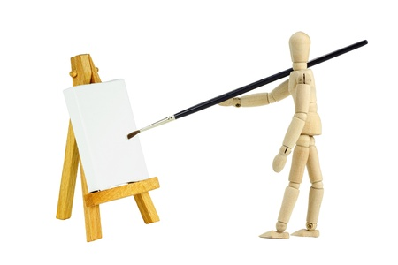 Wooden mannequin with an easel with a blank canvas to be used for text and other purposes by the designer Zdjęcie Seryjne