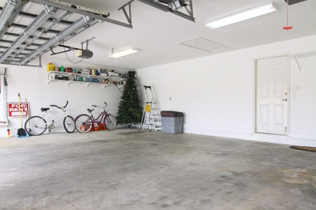 An almost empty garage to be used as storage for junk that will be collected over the years photo