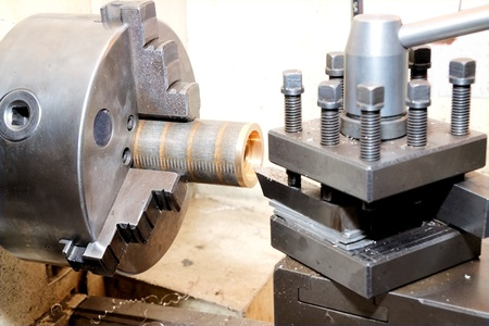 Close-up of the turning of a golden bezel on an old-fashion manual lathe Stock Photo