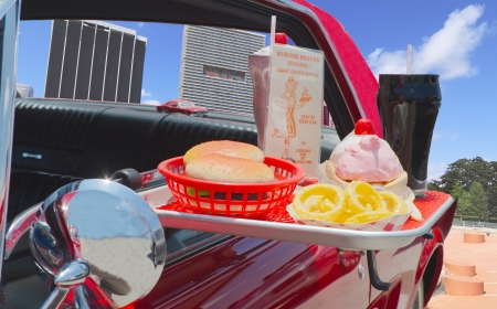Close up of a 1950's drive-in food tray with burger, fries and a soda