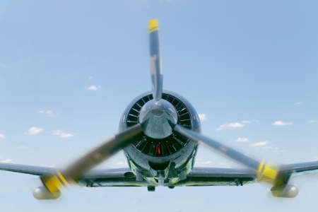 Close up of a low flying one engine aircraft Фото со стока