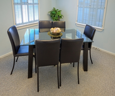 small table: Overview of a small meeting room as usually found in small office buildings  Stock Photo