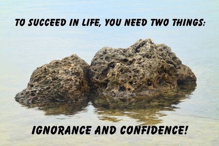 ignorance: Inspirational quote about life with rocks in the water as background symbolizing ignorance and confidence Stock Photo