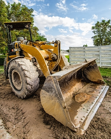 close up of a working back hoe on a construction site
