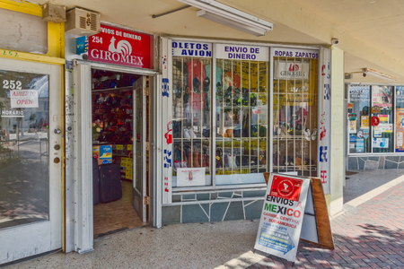 Homestead, FLORIDA - August 04, 2015: Hispanic storefront where people in the local Hispanic community can purchase a variety of goods and services.