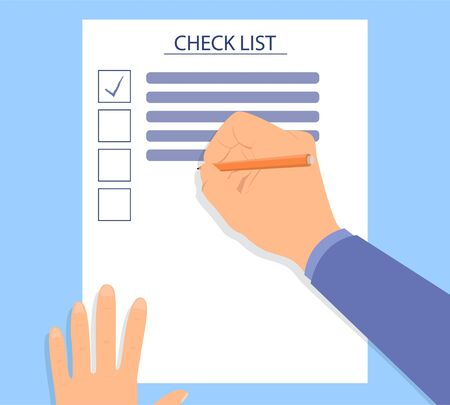 Hand filling checklist on a desk