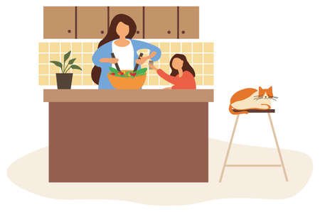 Daughter helping her Mom to cook dinner
