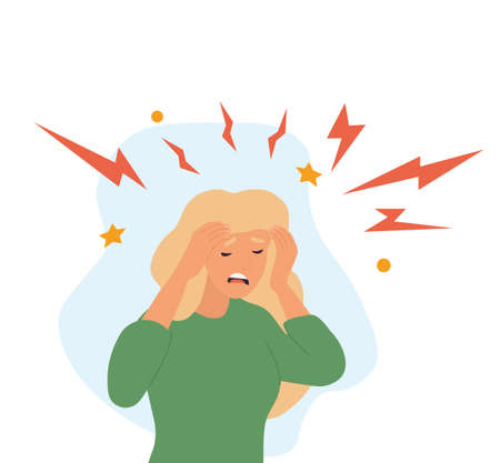 Woman with a morning migraine clutching her head