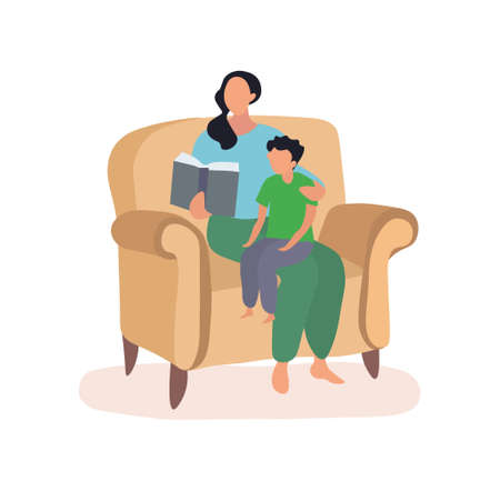 Mother and son sitting in a chair reading a book