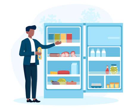 Man measures temperature in fridge