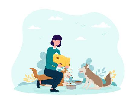 Young female volunteer feeding dogs