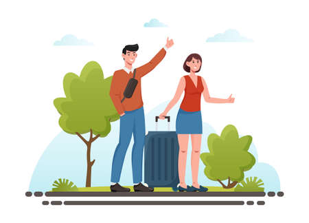 Young couple with luggage standing near road and hitchhiking