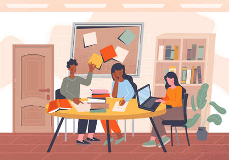 Group of students studying together at a table in college